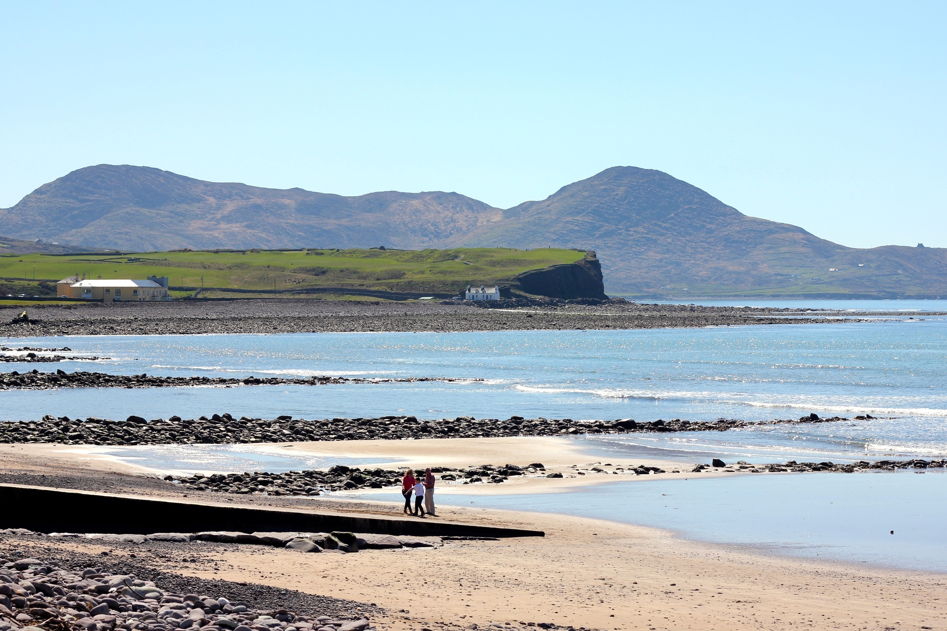 Family walking along the beach in Waterville